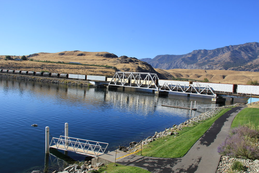 A photo of a fuel train crossing the Columbia River at Pateros, WA. This photo serves as a link to Coleman Oil's Bio Fuels information page.