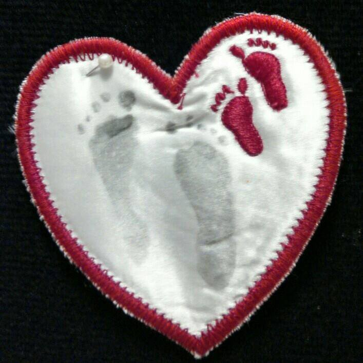 Audrey's sweet little footprints. This heart easily fits in the palm of your hand.