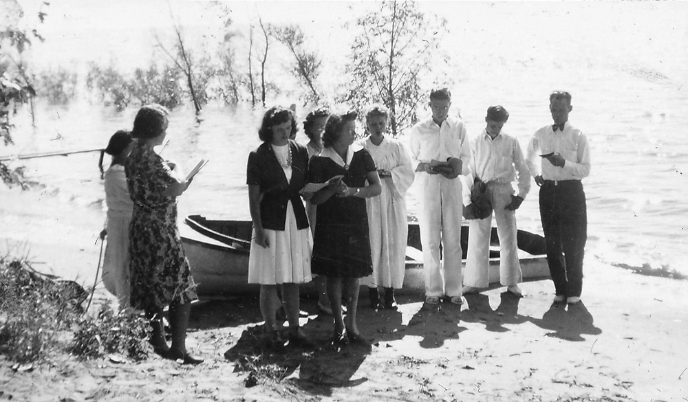 Ernie Rockstad about to baptize a very special person, his wife Ilene Dixon Rockstad, during the summer of 1943.