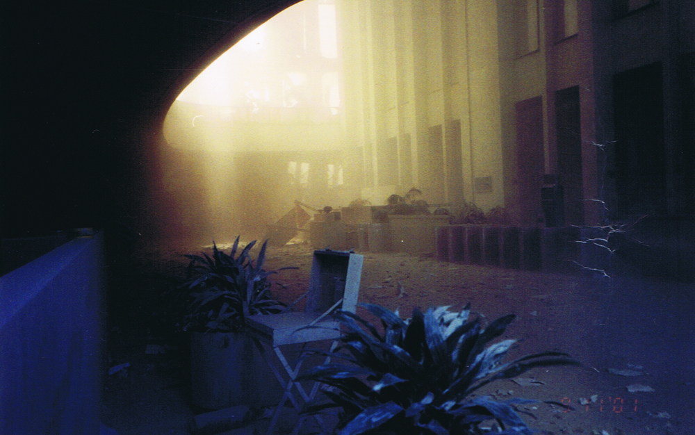 photo of deserted dust-covered WTC North Tower lobby on 9-11
