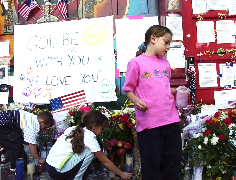 children at firehouse memorial after 9-11