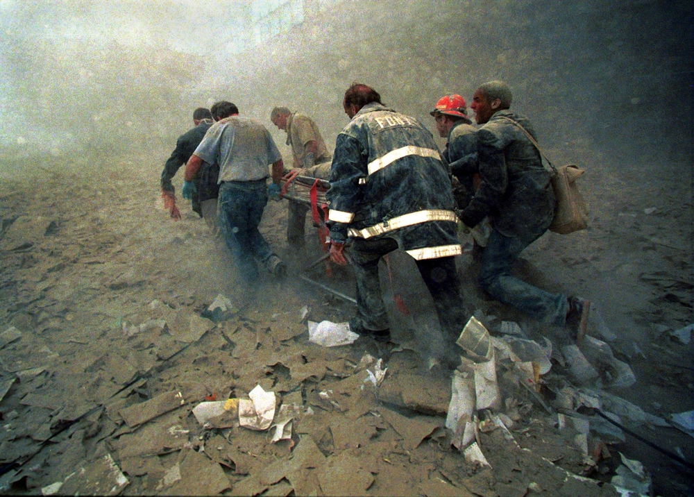 firefighters rescuing injured firefighters on 9-11