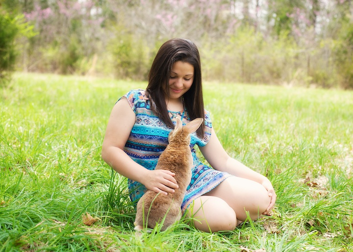 girl playing with bunny