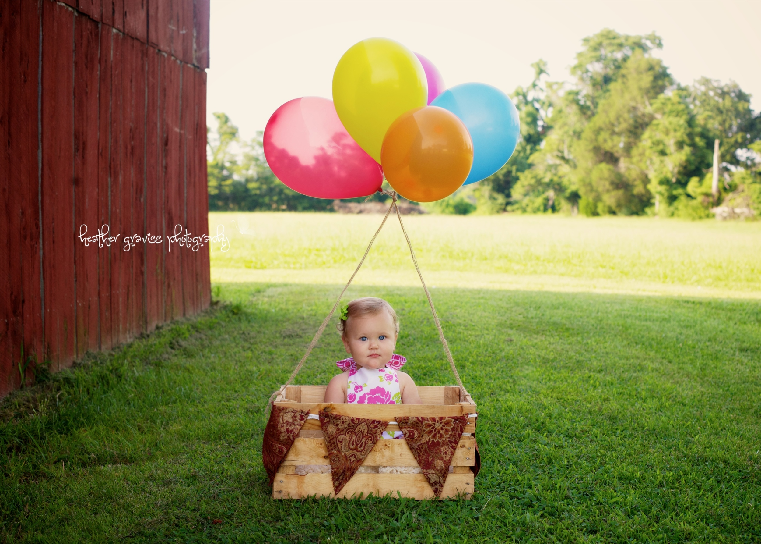 baby in balloon basket