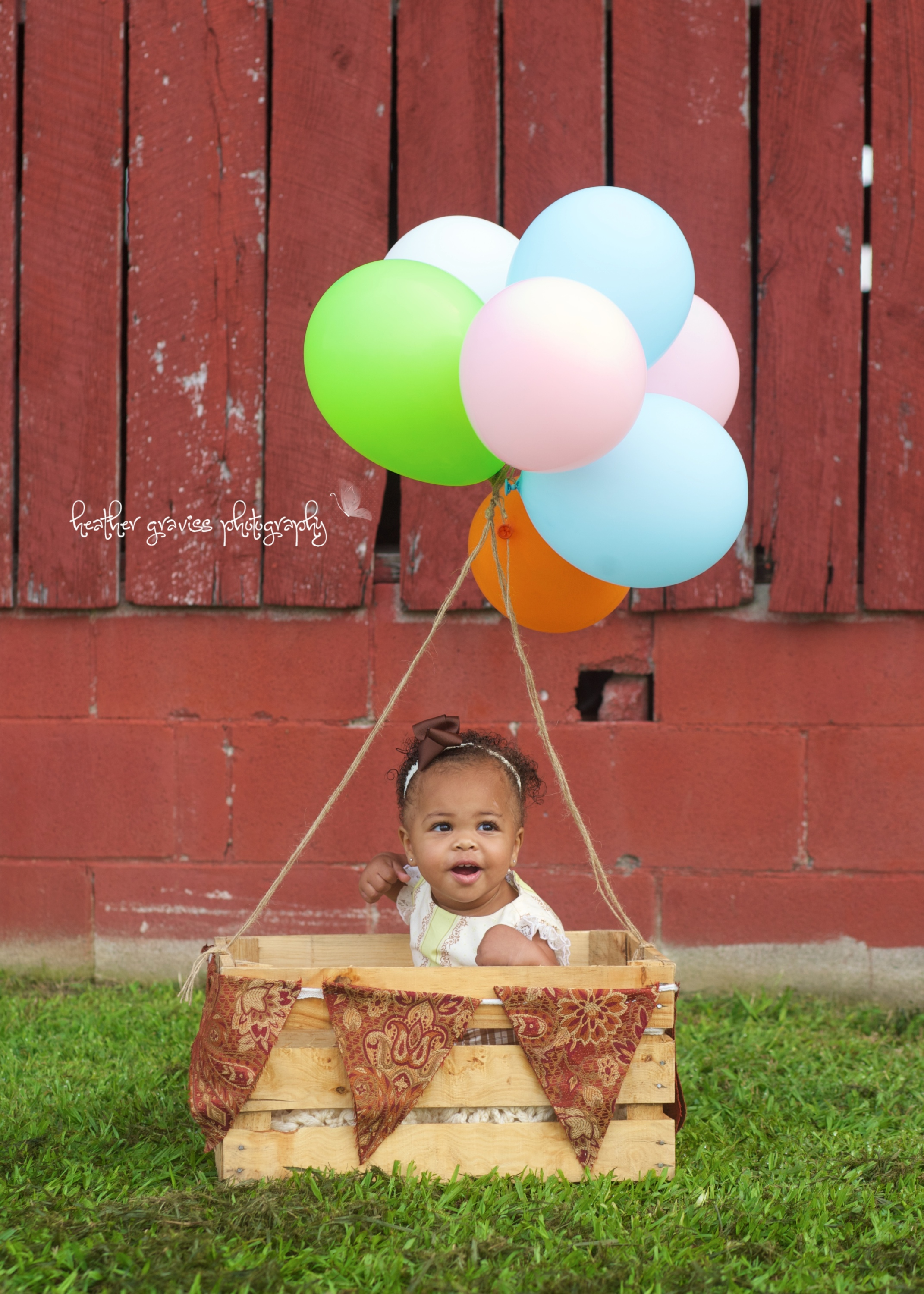 baby in hot air balloon basket
