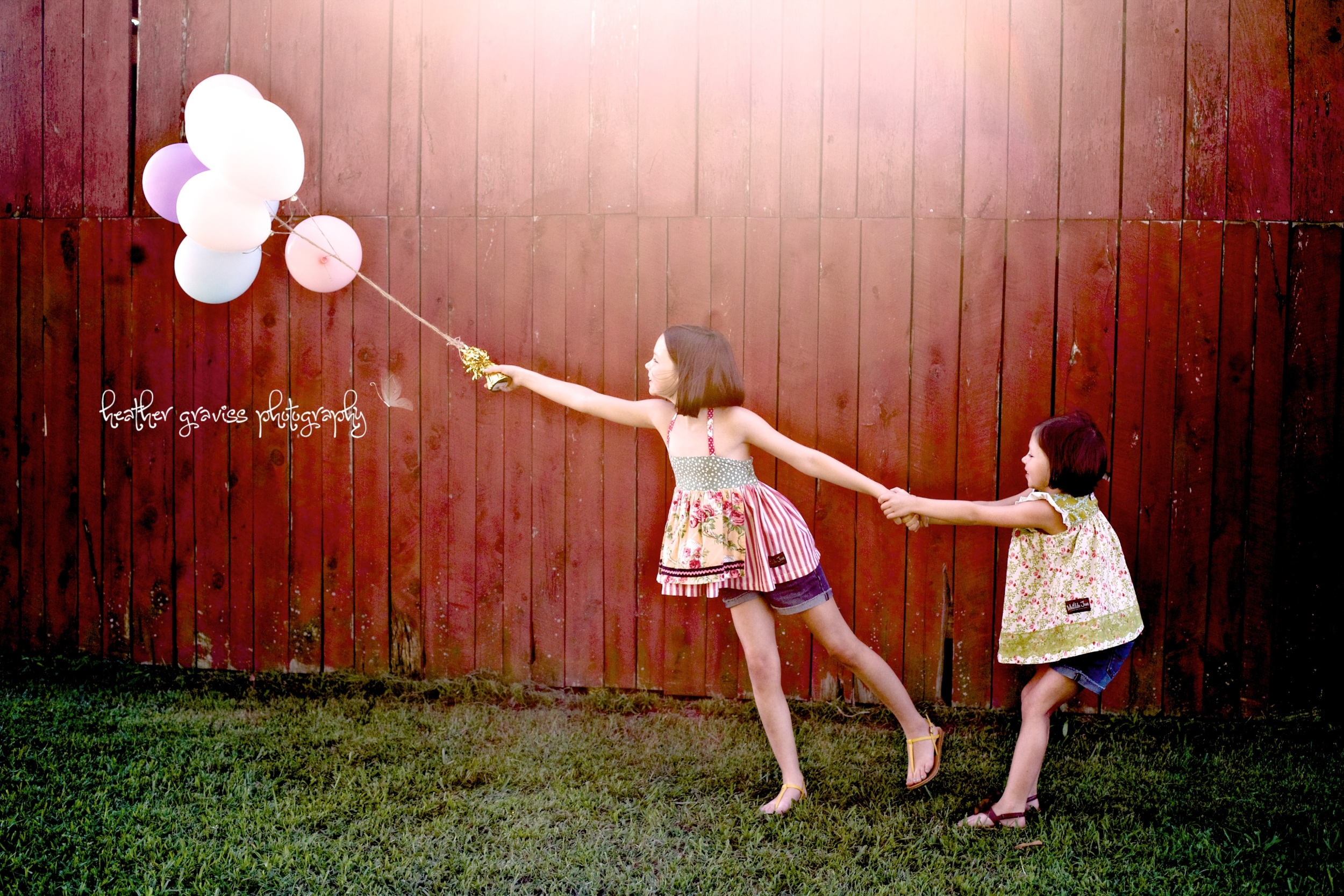 girls flying away with balloons