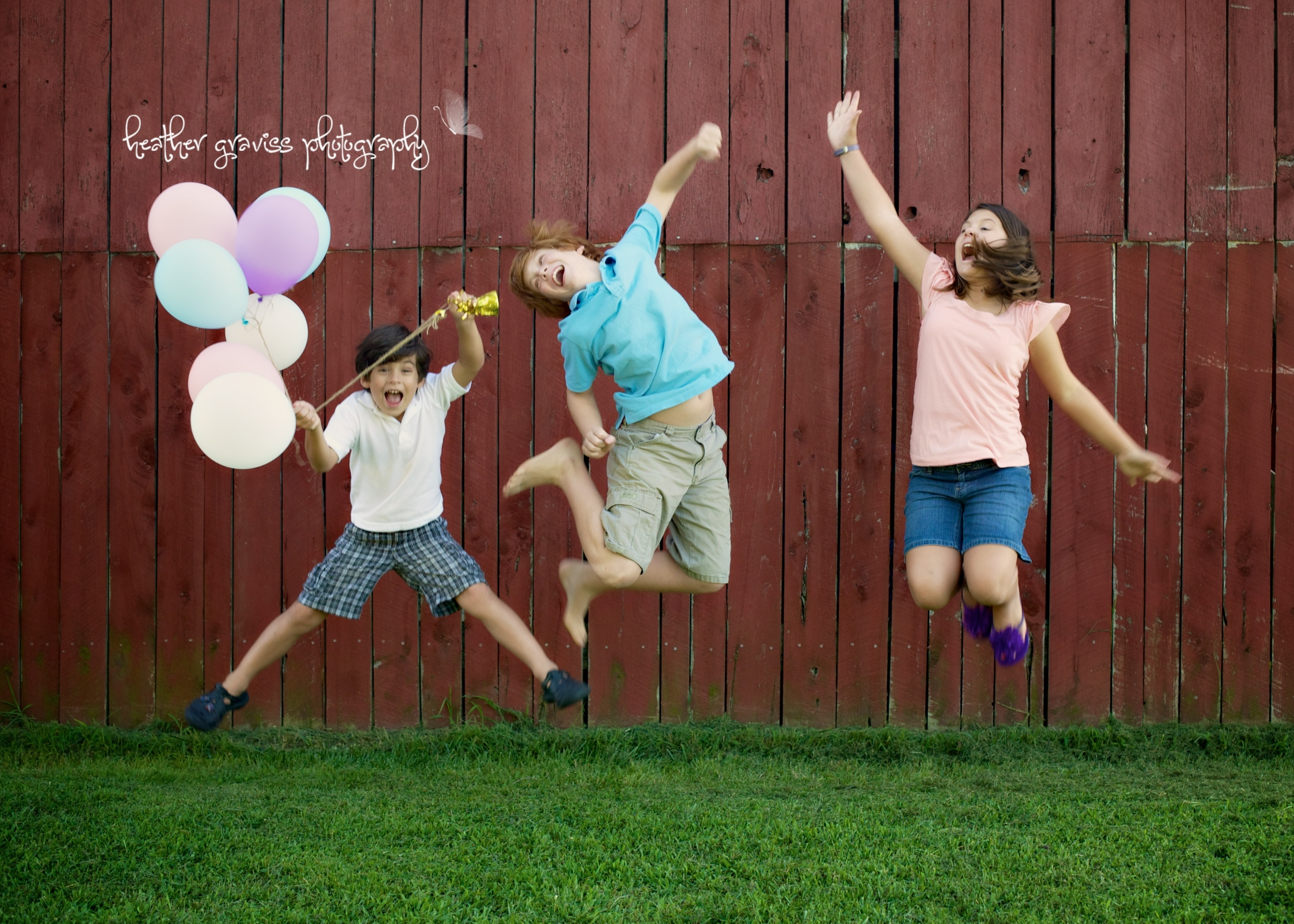 kids jumping with balloons