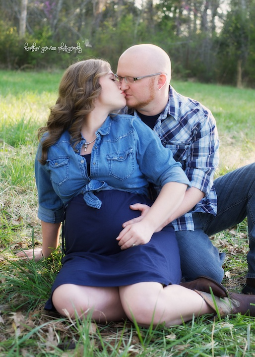 kissing pregnant couple