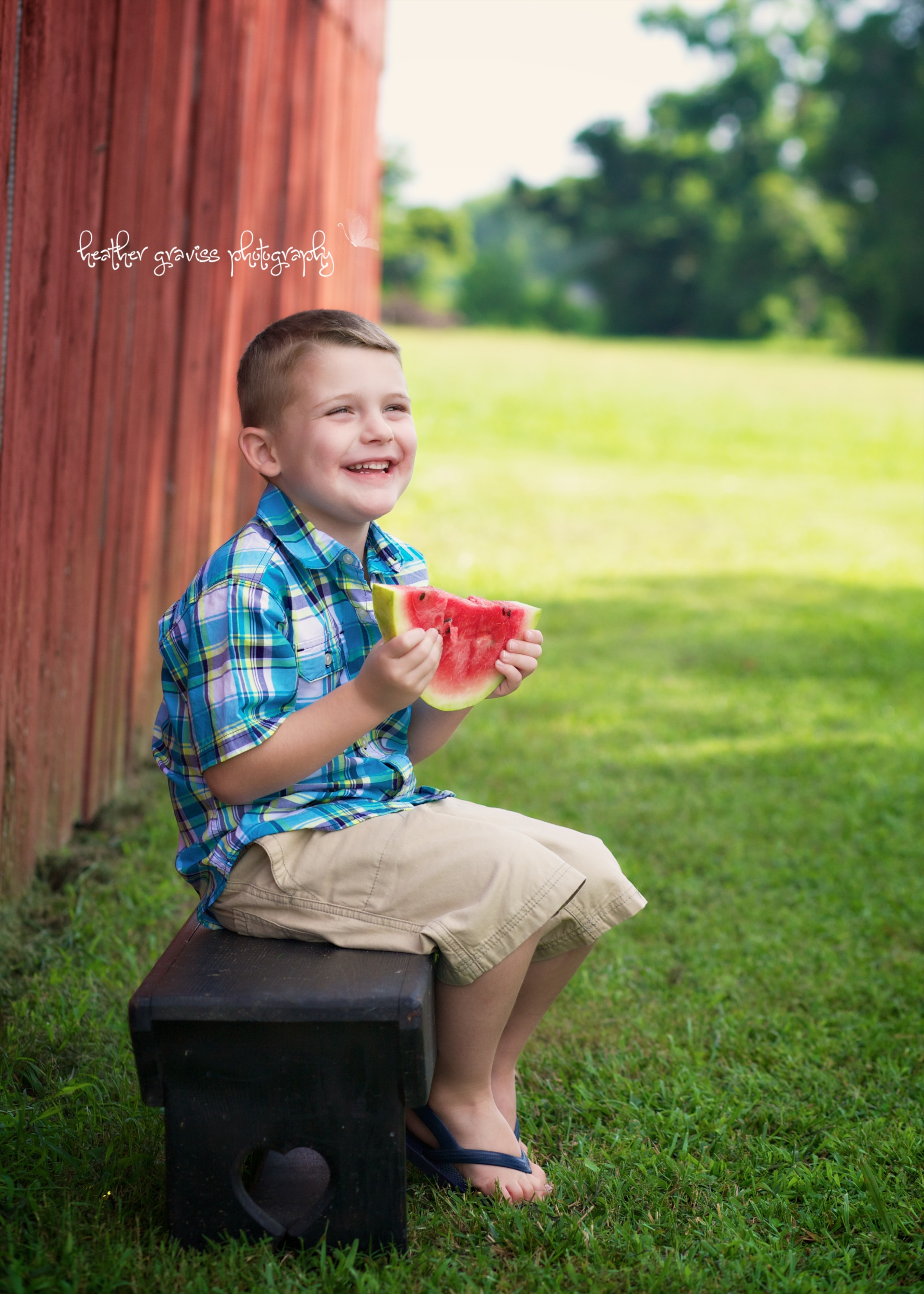 laughing boy with watermelon