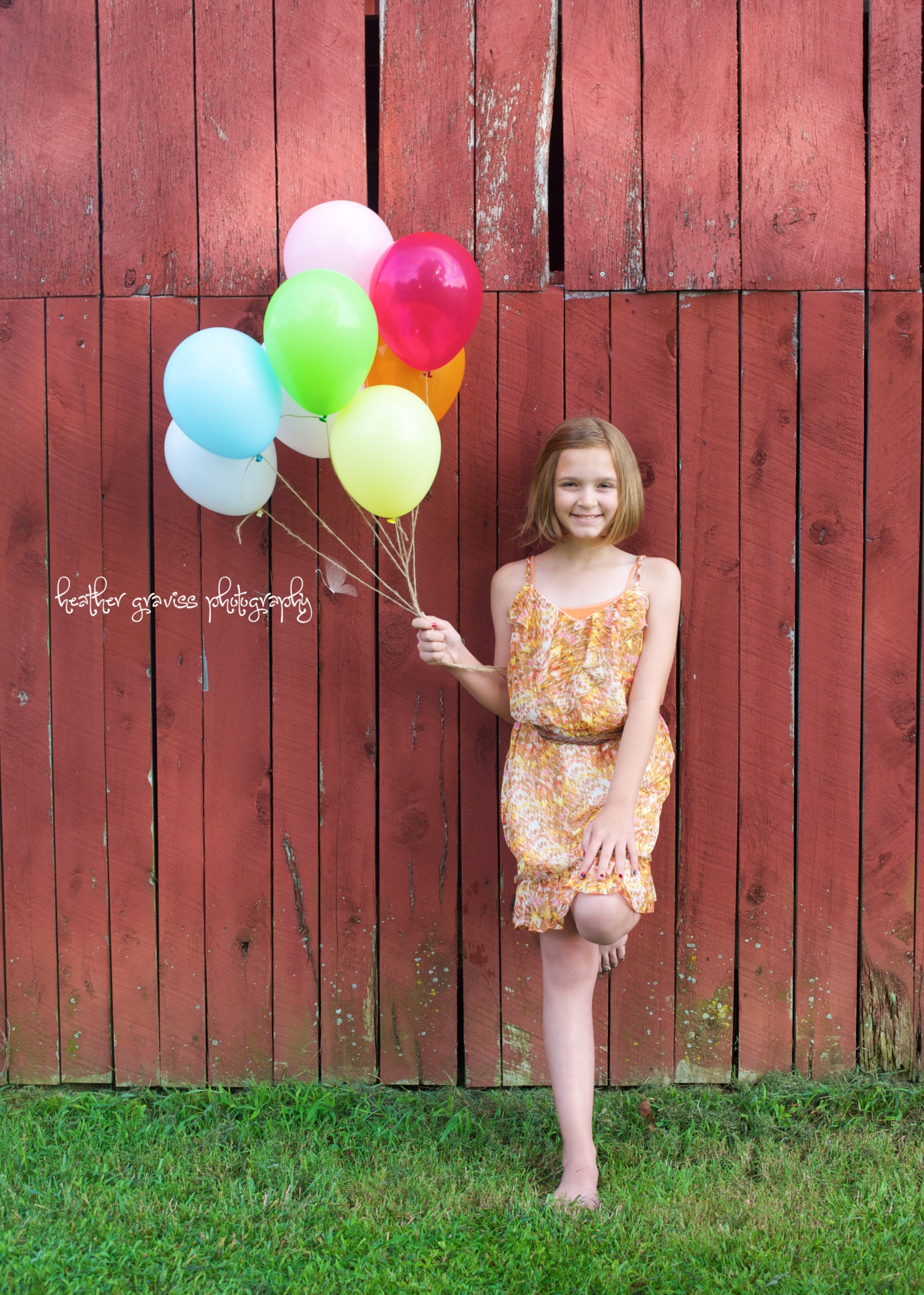 leaning girl with balloons