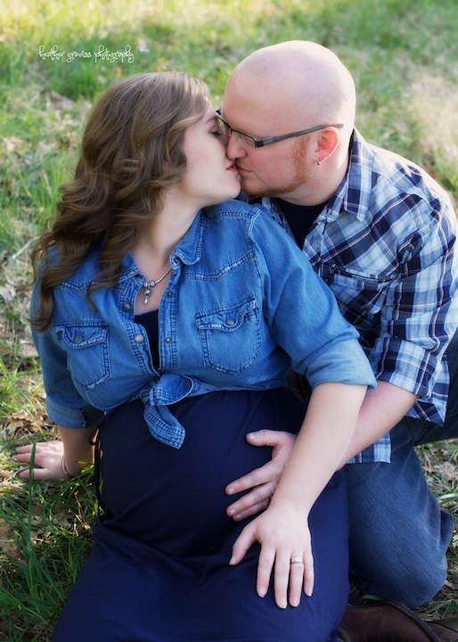 pregnant couple kissing