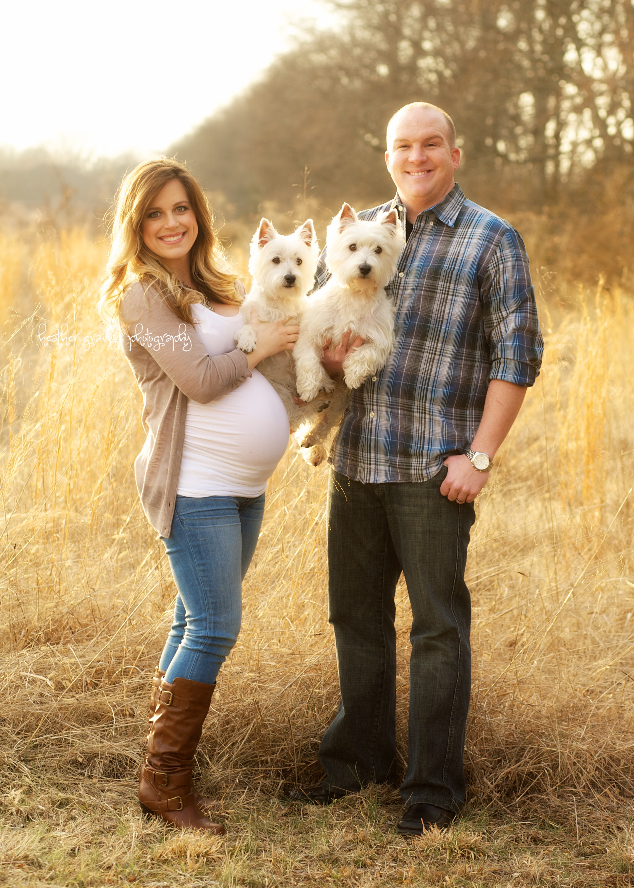 pregnant couple with dogs