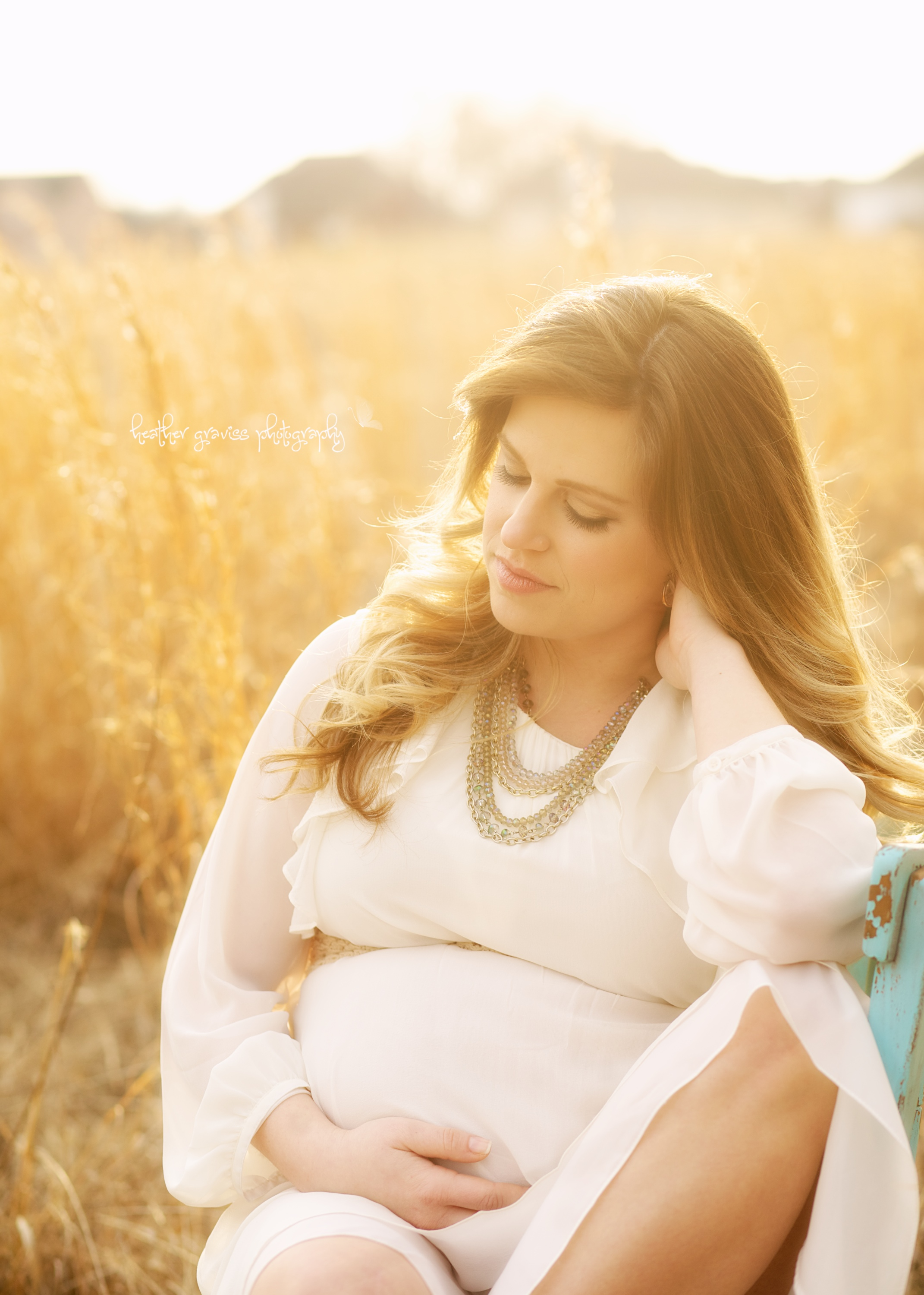 serene pregnant woman in field