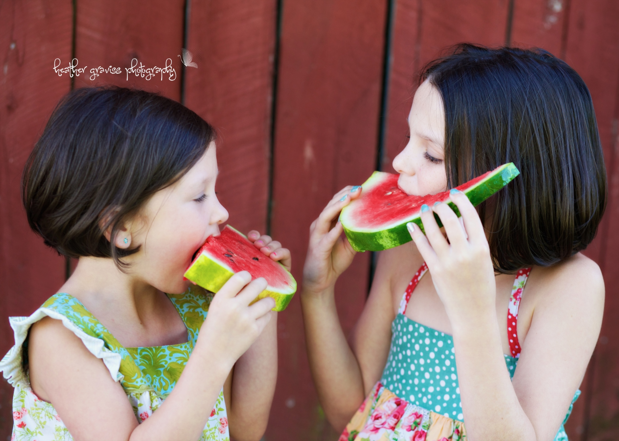 sisters eating watermelon