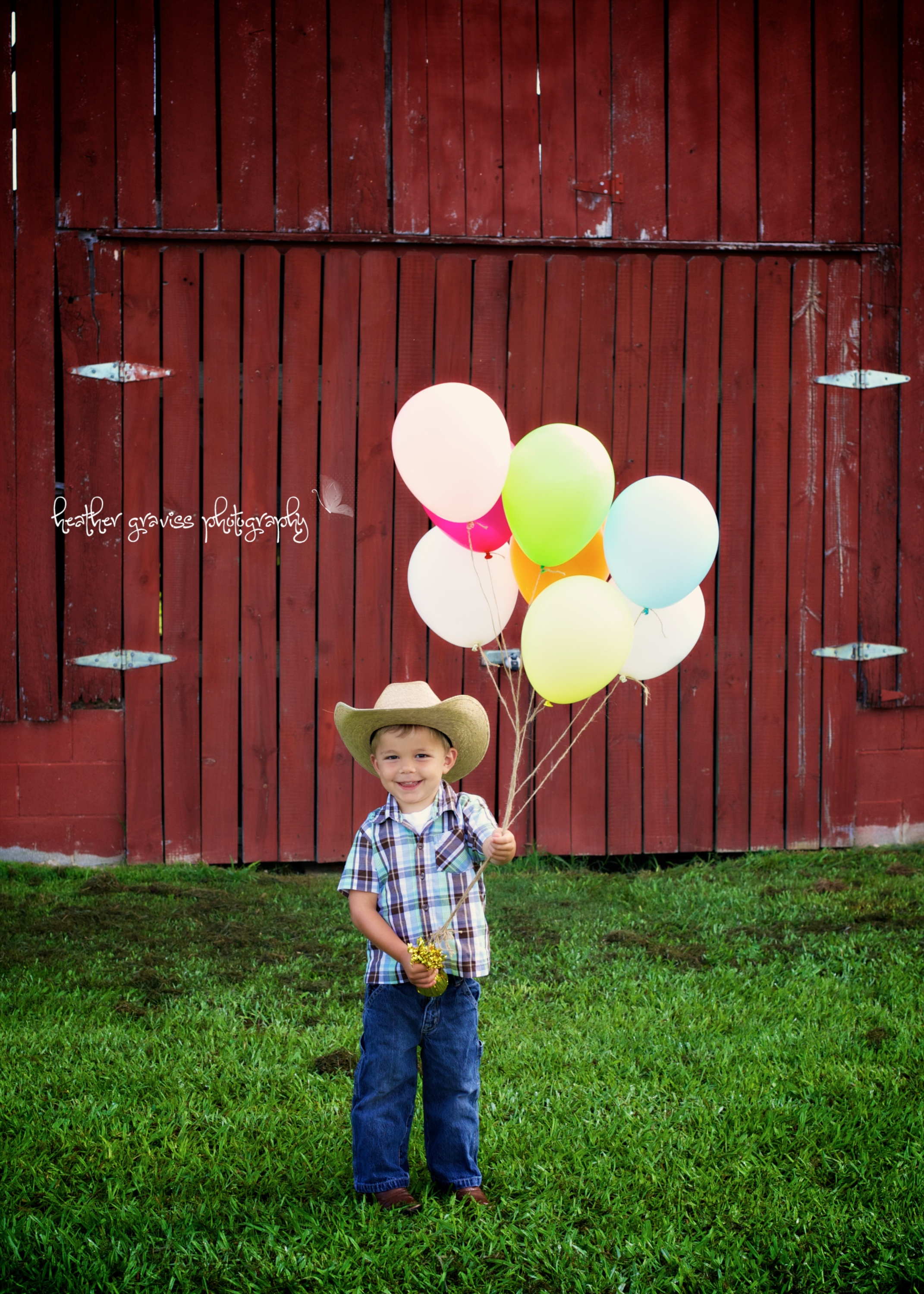 small cowboy with balloons