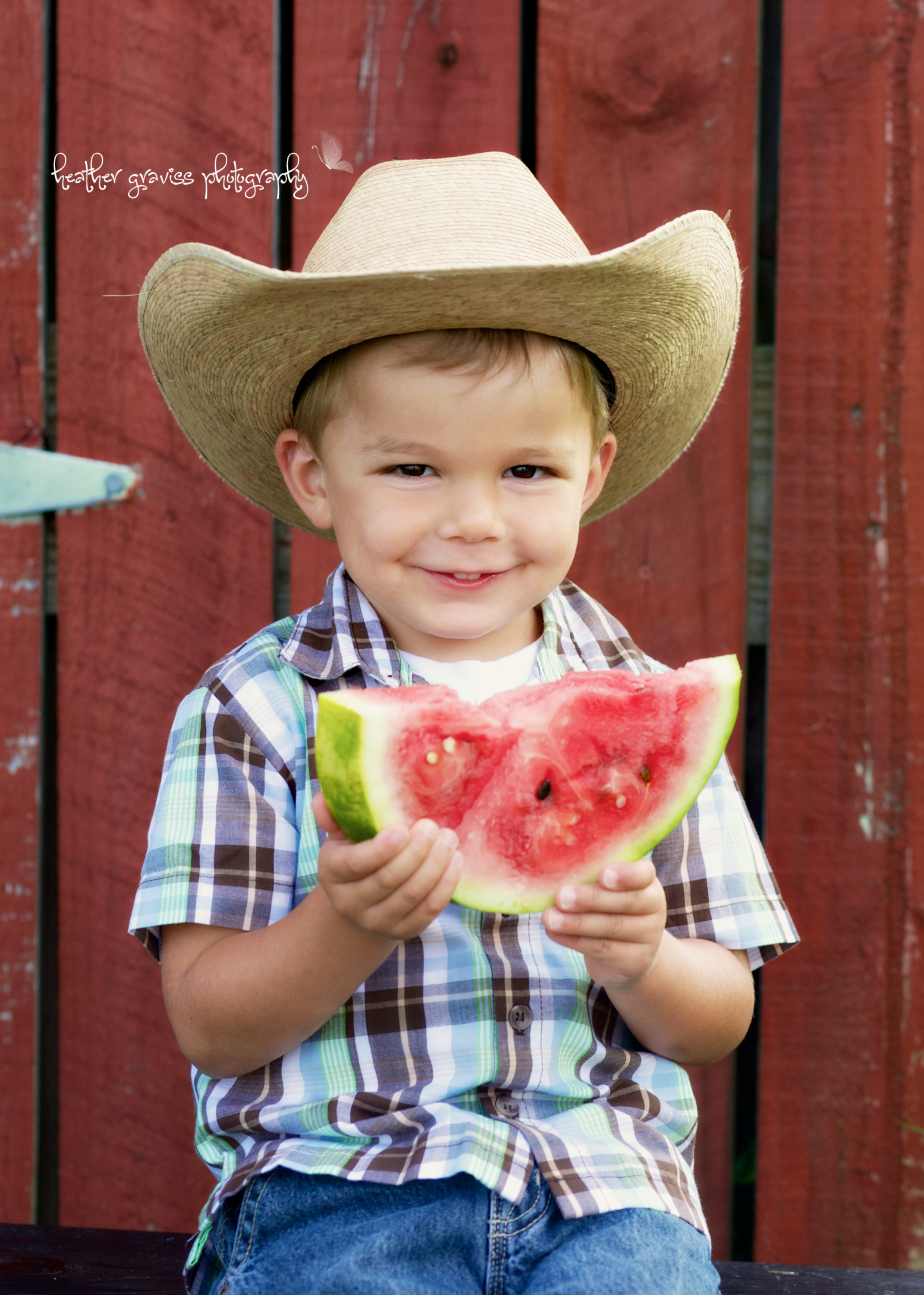 smiling boy eating watermelon