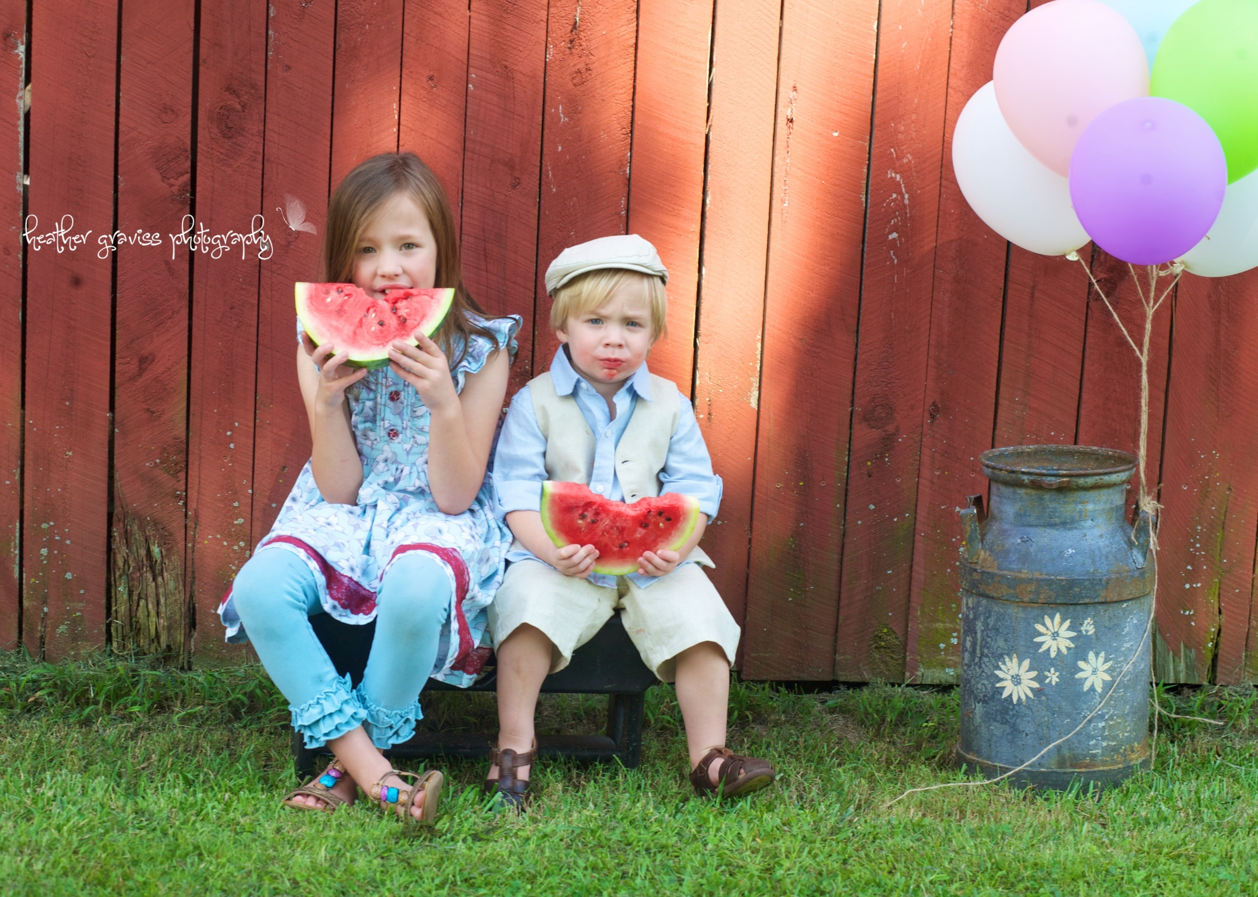 siblings eating watermelon