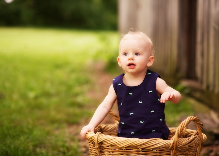 baby standing in basket