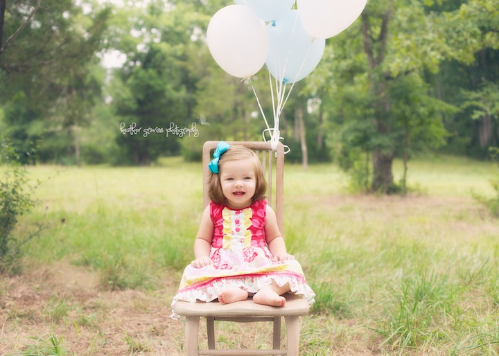 happy baby girl and balloons