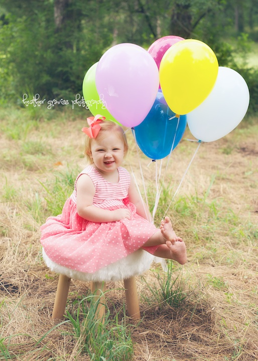 happy baby with balloons