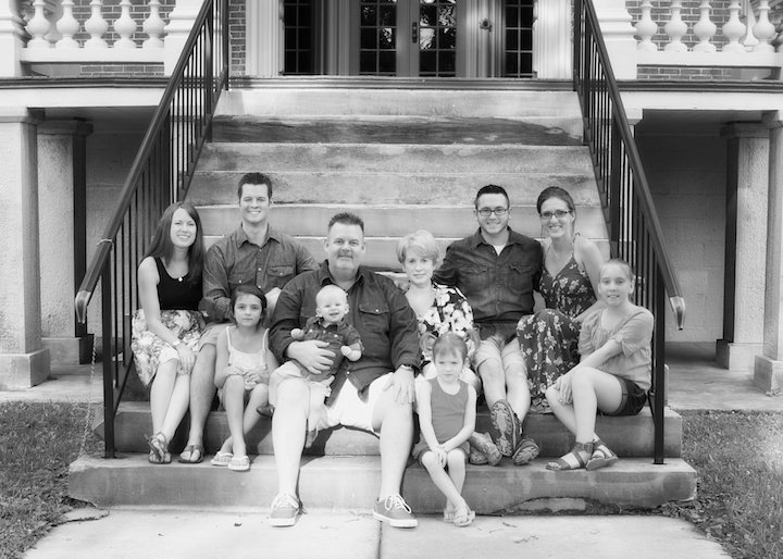large family on steps