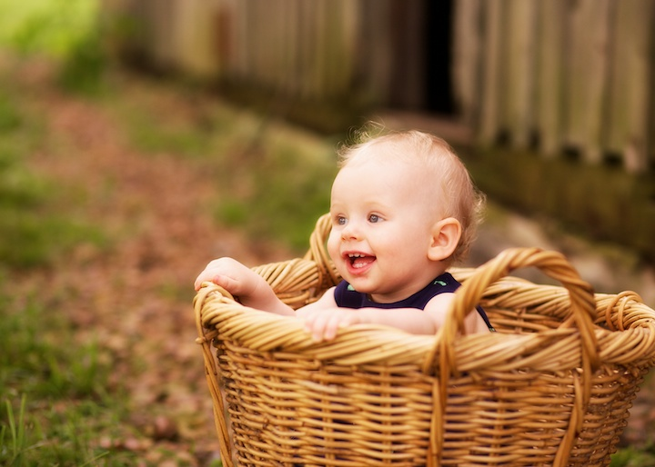 laughing baby in basket