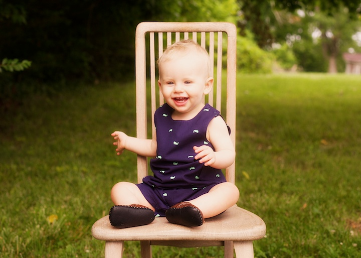 laughing baby on chair