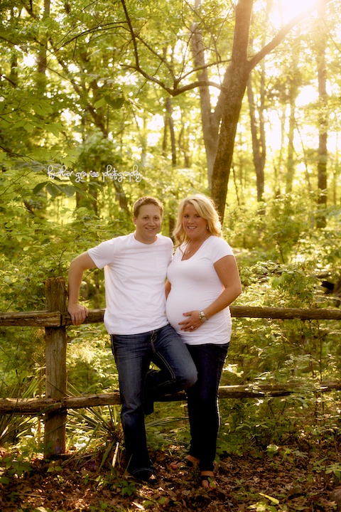 pregnant couple by fence