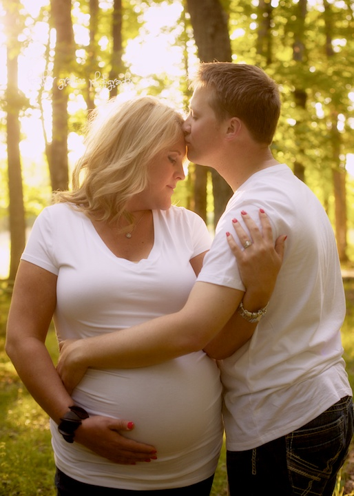 pregnant couple in woods