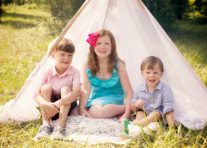 siblings in tent