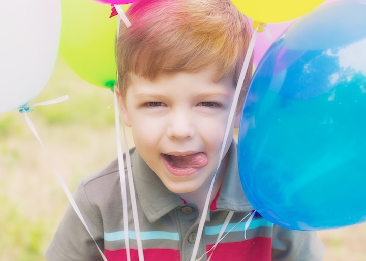 silly boy with balloons