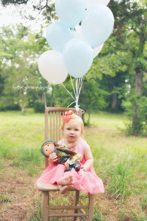 small girl with balloons