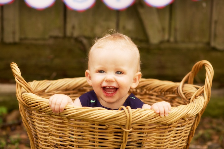 smiling baby in basket
