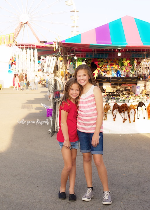 sisters hug at fair
