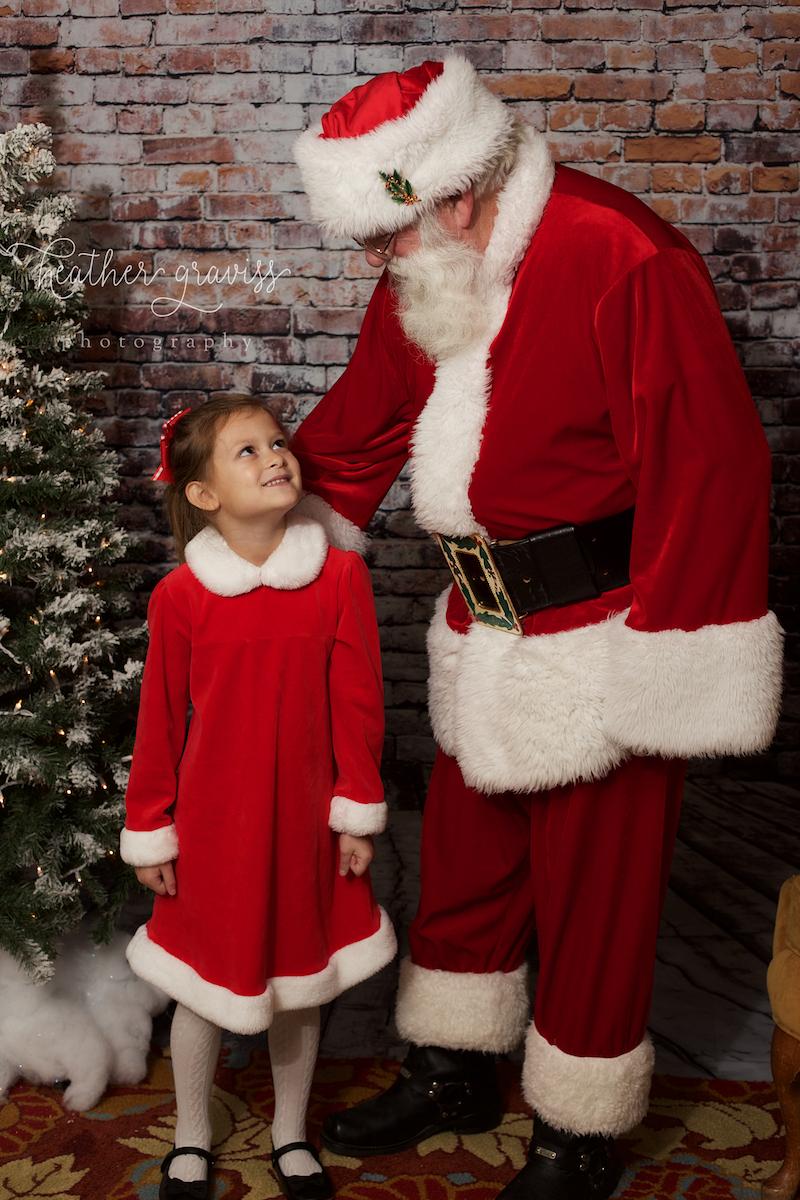 little-girl-looking-at-santa.jpg