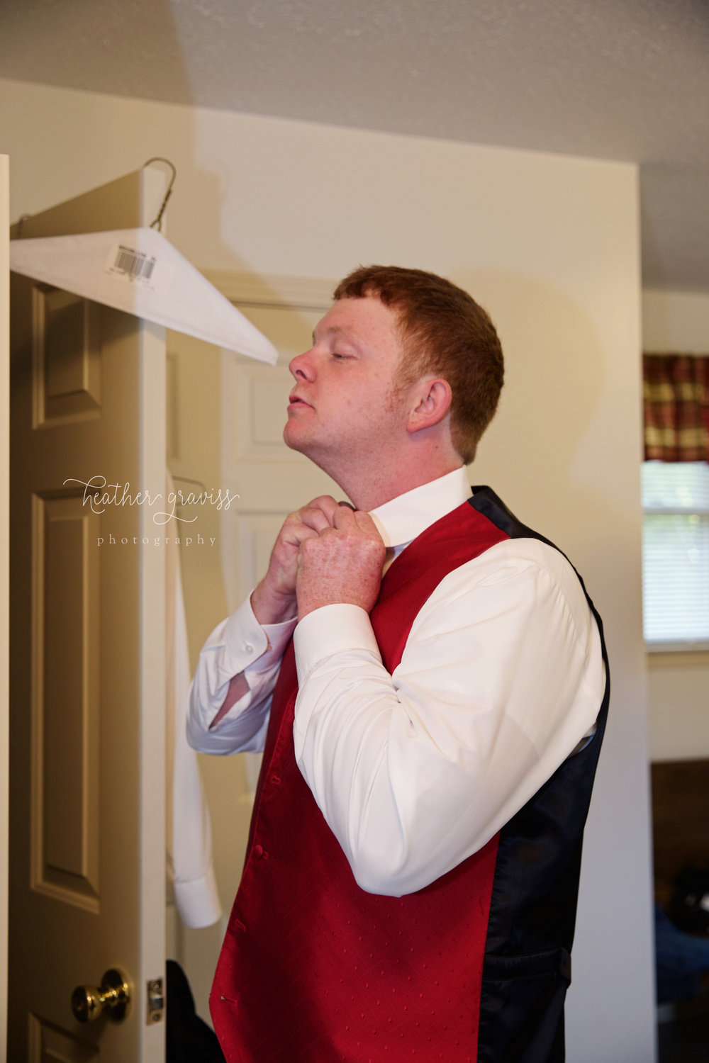 11 groom-straightening-tie.jpg