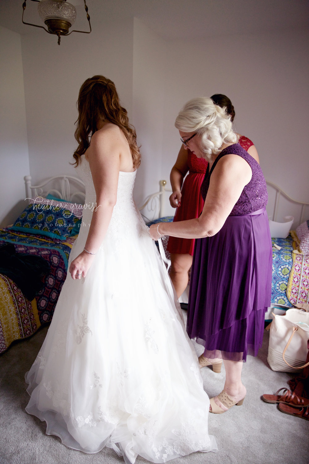 13 mother-of-bride-helping-with-dress.jpg
