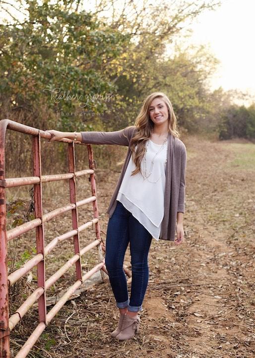 girl-on-farm-fence.jpg