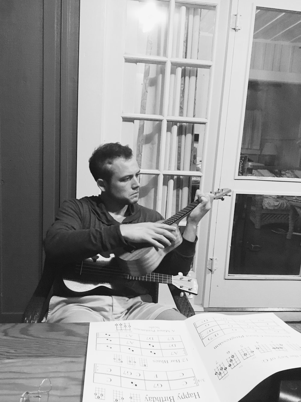 "Taron Egerton , actor and dear friend, with his (multiple)  Hanalei Strings  ukulele(s) and chord chart. He sent us this photo after taking our group ukulele lesson, having mastered ""Happy Birthday"" and playing like a pro..."