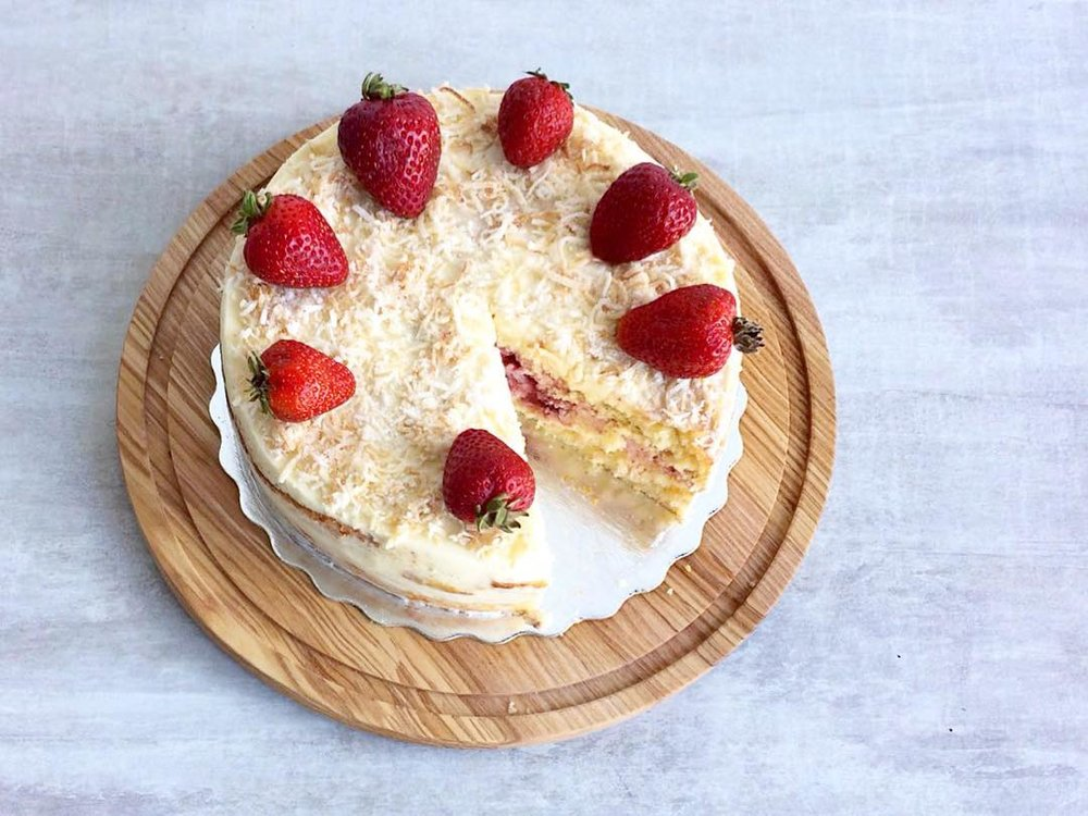 Our Strawberry-lemon Sponge Cake is layered with coconut buttercream that's topped with toasted coconut shreds.