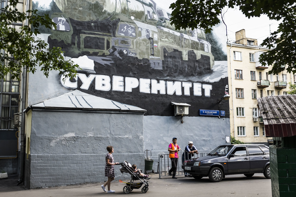"Graffiti saying ""Sovereignty"" and showing ""Sickle B"" intercontinental ballistic missile is seen in Moscow yard where it was made in October 2014 as a part of a performance to celebrate president Putin's birthday"