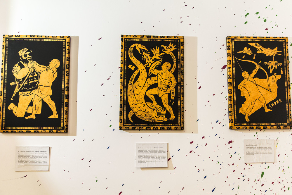 Paintings representing Putin performing 3 of 12 Hercules' labours is being presented at an exhibition in Moscow