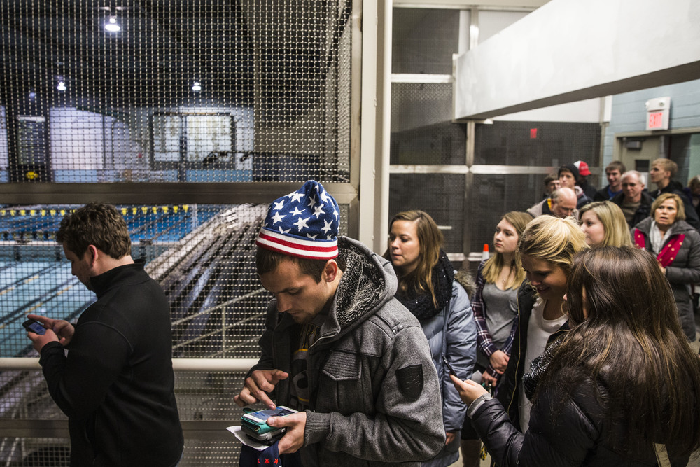 People stand in a line to attend Donald Trump's rally in Iowa City