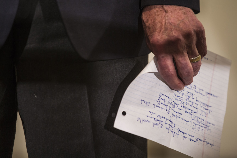 Senator Chuck Grassley (R-IA) holds his speech draft in his hand as he opens for Ben Carson in Iowa City