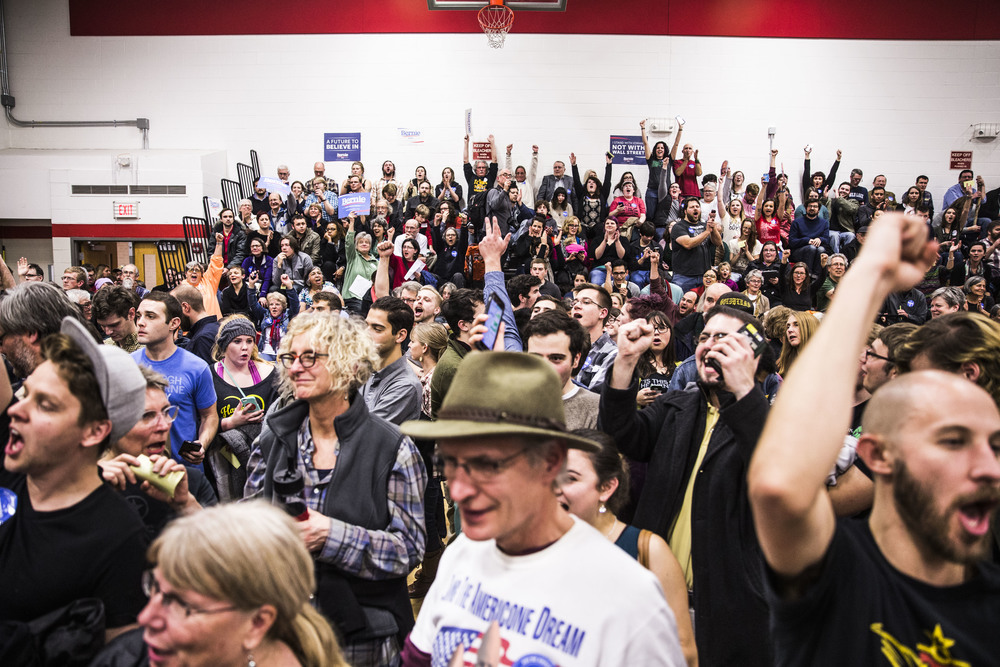 Bernie Sanders supporters cheer as they win at caucus at their precinct