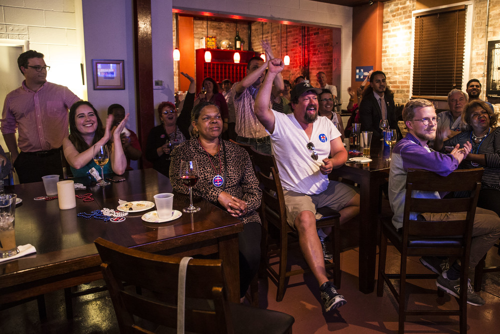 Hillary Clinton's supporter cheer as they have a Supertuesday watchparty