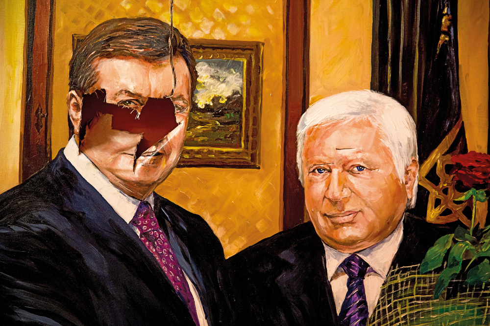 Portrait of Ukrainian ex-president Yanukovich and ex-prosecutor general Pshonka is seen damaged after protesters assaulted Yanukovich's residency when he fled the country. The portrait is a part of an exposition of president's goods that was installed in Kyiv the summer after the revolution won.