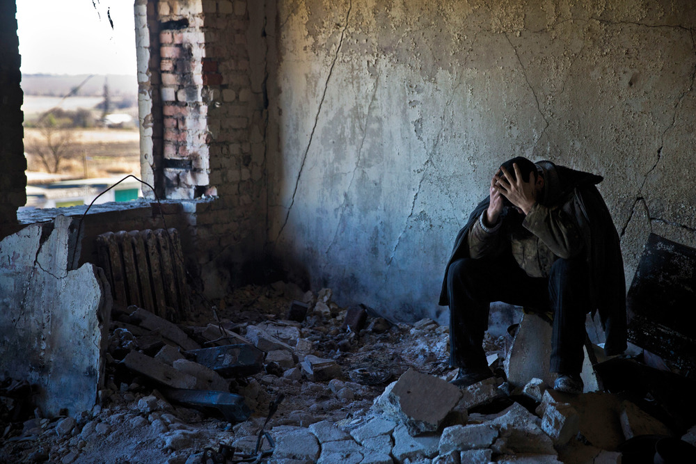 Ukrainian soldier reflects as he is forced for labour among other prisoners of war in Ilovaysk