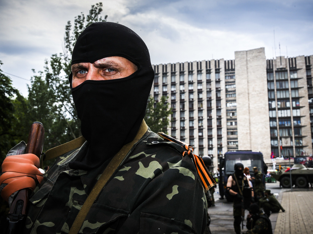 An armed separatist is seen in Donetsk