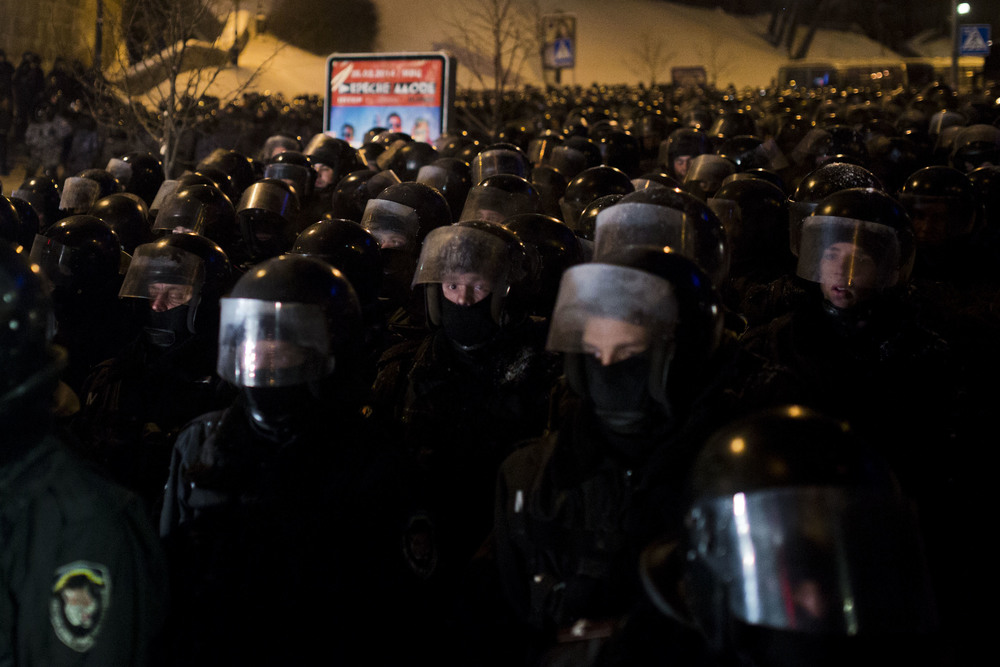 Riot police officers prepare for an attempt to dissolve the crowd that gathered at Kiev's main square Maidan